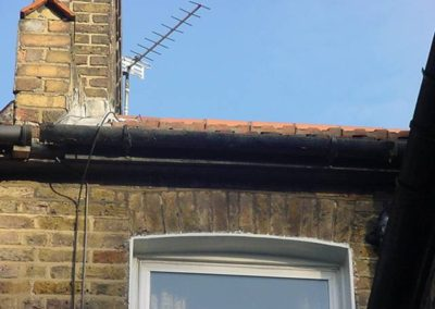 Cast iron gutter This is leaking allowing dampness into the brickwork