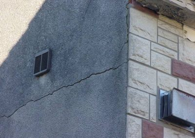 Cracks in render These are allowing dampness into the property